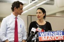 -                Huma Abedin, alongside her husband, New York mayoral candidate Anthony Weiner, speaks during a news conference at the Gay Men's Health Crisis headquarters, Tuesday, July 23, 2013, in Ne