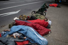 -                Protestors camp out in front of city hall Monday, July 22, 2013, in Portland, Ore., to draw attention to the plight of the homeless. Mayor Charlie Hales said at a Monday news conference
