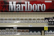 -                In this Wednesday, July 17, 2013, photo, Marlboro cigarettes are on display in a CVS store in Pittsburgh. Altria reports quarterly earnings on Tuesday, July 23, 2013.  (AP Photo/Gene J.