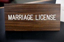 "-                A placard on a desk reading ""marriage license"" is at a Montgomery County office, Wednesday, July 24, 2013, in Norristown, Pa. Two women have been married in a religious ceremony Wednesd"