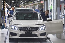 -                FILE - In this Wednesday, May 8, 2013 file photo a CLA car is assembled in the car manufacturing plant of Mercedes-Benz Manufacturing Hungary Kft., an affiliate of Daimler AG of German
