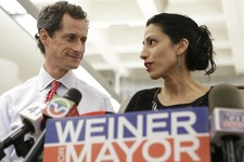 -                FILE - In this July 23, 2013 photo, Huma Abedin, alongside her husband, New York mayoral candidate Anthony Weiner, speaks during a news conference at the Gay Men's Health Crisis headqua
