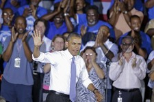 -                President Barack Obama waves  as he arrives to speak about the economy, Thursday, July 25, 2013, at the Jacksonville Port Authority in Jacksonville, Fla. A day after he kicked off the t