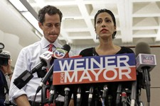 -                New York mayoral candidate Anthony Weiner, left, listens as his wife, Huma Abedin, speaks during a news conference at the Gay Men's Health Crisis headquarters, Tuesday, July 23, 2013, i
