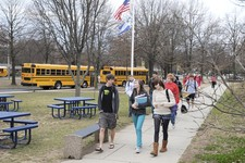 -                In a March 2012 photo, Severna Park High School students arrive for class. About 40 percent of U.S. public high schools open before 8 a.m., according to the U.S. Department of Education