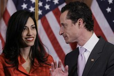 -                FILE - In this Jan. 5, 2011, file photo, Rep. Anthony Weiner, D-N.Y., and his wife, Huma Abedin, aide to Secretary of State Hillary Rodham Clinton, talk after a ceremonial swearing in o