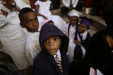 -                AP10ThingsToSee - Jaquin Nelson, 6, wears a hooded sweatshirt in  reaction to a Florida jury's acquittal of George Zimmerman, who was found not guilty of second degree murder in the sho