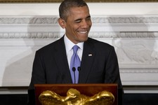 -                President Barack Obama winks as he speaks  at an Iftar dinner celebrating Ramadan in the State Dining Room of the White House, Thursday, July 25, 2013, in Washington. (AP Photo/Carolyn