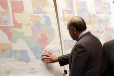 "-                File - In this May 30, 2013 file photo, Texas state Sen. Juan ""Chuy"" Hinojosa looks at maps on display prior to a Senate Redistricting committee hearing, in Austin, Texas. Attorney Gene"
