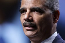 -                FILE - In this July 25, 2013 file photo, Attorney General Eric Holder speaks in Philadelphia. Holder tells Russia US won't seek death penalty for Edward Snowden. (AP Photo/Matt Rourke,