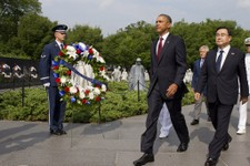 -                President Barack Obama walks with Special Envoy from the Republic of Korea Kim Jung Hun, right, during a commemorative ceremony at the Korean War Veterans Memorial on the 60th anniversa