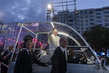 -                Pope Francis waves from his popemobile as he arrives for the Stations of the Cross event on Copacabana beach in Rio de Janeiro, Brazil, Friday, July 26, 2013. Also known as the Via Cruc