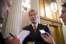 -                Sen. John Thune, R-S.D., chair of the Senate Republican Caucus, speaks with reporters just before the final vote on whether to reverse the recent hike in rates for government student lo