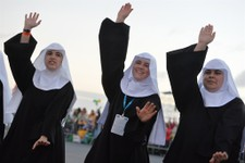 -                Nuns dance as they wait for the start of a a vigil on Copacabana beach in Rio de Janeiro, Brazil, Saturday, July 27, 2013.  Pope Francis drew faithful to Rio's Copacabana beach on Satur