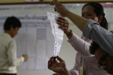 -                Election officials count ballots at a polling station at Chadomouk High School, in Phnom Penh, Cambodia, Sunday, July 28, 2013. Cambodians went to the polls Sunday in an election almost