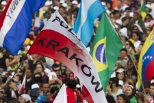 -                A Polish flag that bears the name of Krakow, the host city for the 2016 World Youth Day, is waved during the WYD closing Mass in Rio de Janeiro, Brazil, Sunday, July 28, 2013. Krakow is