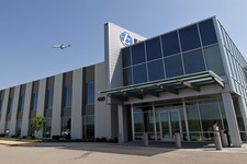 -                This Monday, April 2, 2012, photo, shows the technology and innovation center of Express Scripts at N. Hanley Road and Interstate 70 in St. Louis. Express Scripts Inc. reports quarterly