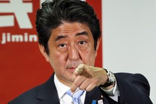 -                FILE - In this July 22, 2013 file photo, Japanese Prime Minister Shinzo Abe, president of the Liberal Democratic Party, points a reporter during a press conference in Tokyo. Japan's ind