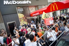 -                Demonstrators in support of fast food workers protest outside a McDonald's as they demand higher wages and the right to form a union without retaliation Monday, July 29, 2013, in New Yo