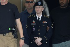 -                Army Pfc. Bradley Manning is escorted out of a courthouse in Fort Meade, Md., Tuesday, July 30, 2013, after receiving a verdict in his court martial. The successful prosecution of Army