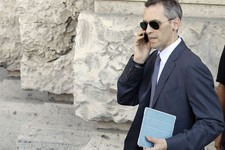 -                Silvio Berlusconi's lawyer Niccolo' Ghedini uses his mobile phone outside the Court of Cassation building where Berlusconi's case on tax fraud will be decided, in Rome, Tuesday, July 30