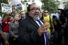 -                Rep. Raul Grijalva, D-Nev., center, joins immigration reform supporters as they block a street on Capitol Hill in Washington, Thursday, Aug. 1, 2013, during a rally protesting immigrati