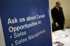 -                In this  Monday, June 24, 2013, photo, a recruiter waits to meet with job seekers at a career fair, in King of Prussia, Pa. The Labor Department reports on the number of Americans who a