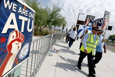 -                Members of the Amalgamated Transit Union Local 1433 strike in front of the First Transit Inc., bus depot on Thursday, Aug. 1, 2013 in Tempe, Ariz, after hundreds of bus operators overwh