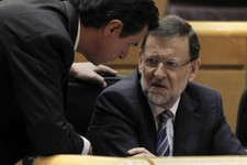 -                Spain's Prime Minister Mariano Rajoy, right, speaks with Spain's Industry, Commerce, Tourism Jose Manuel Soria, left, during a Spanish Parliament session in Madrid, Spain, Thursday, Aug