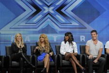 "-                Demi Lovato, from left,  Paulina Rubio, Kelly Rowland and Simon Cowell, judges on the FOX series ""The X Factor,"" take part in a panel discussion on the show during the FOX 2013 Summer T"