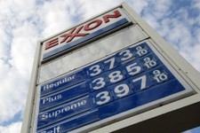-                FILE - This Feb. 27, 2012 file photo shows gas prices at a Pittsburgh Exxon mini-mart. Exxon Mobil Corp. reports quarterly financial results before the market open on Thursday, Aug. 1,