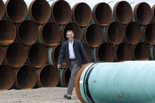 -                FILE - This March 22, 2012 file photo shows President Barack Obama arriving at the TransCanada Stillwater Pipe Yard in Cushing, Okla. Obama has revived debate about the number of jobs t