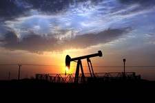 -                FILE - In this  Monday Oct. 29, 2012, file photo, an oil pump operates in the desert oil fields of Sakhir, Bahrain, at sunset. New troves of oil are being found all over the globe and e