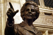 -                FILE - A bronze statue of former British Prime Minister Baroness Margaret Thatcher, unveiled by Baroness Thatcher herself, is seen inside the Palace of Westminster, London, in this Wedn