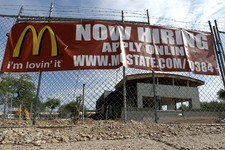 "-                In this Aug. 1, 2013, photo, a ""Now Hiring"" sign hangs in front of a new McDonald's restaurant under construction in Tempe, Ariz. Of the 162,000 jobs the economy added in July 2013, a d"
