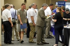 -                FILE - This July 15, 2013 photo, people line up at the job fair  in South Burlington, Vt.  The 162,000 jobs the economy added in July were a disappointment. The quality of the jobs was