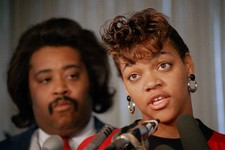 -                FILE - In this Oct. 8, 1988, file photo, Tawana Brawley speaks to reporters with her advisor the Rev. Al Sharpton in Chicago. A grand jury concluded Brawley's story of being raped in Ne