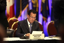 -                Connecticut Gov. Dannel Malloy looks over some note during a session of the National Governors Association meeting Sunday, August, 4, 2013 in Milwaukee.  Democratic governors say they a