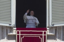 -                Pope Francis delivers his blessing during the Angelus noon prayer he celebrated from the window of his studio overlooking St. Peter's Square at the Vatican, Sunday, Aug. 4, 2013. (AP Ph
