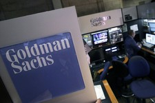 -                FILE - In this March 15, 2012 file photo, a trader works in the Goldman Sachs booth on the floor of the New York Stock Exchange.  On Monday, Aug. 5, 2013, it was announced that the Lond