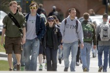 -                FILE - In this April 30, 2012, file photo, students walk across campus at the University of Vermont in Burlington, Vt.  UVM was ranked nineteenth on the best party school list. College