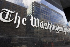 -                FILE -  In this Feb. 27, 2008, file photo, The Washington Post sign is seen on its building in Washington. On Monday, Aug. 5, 2013, the Washington Post announced the paper has been sold