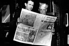 -                In this March 18, 1954 photo, Philip L. Graham, left, and Eugene Meyer look at the first The Washington Post Times Herald, in Washington. Amazon.com founder Jeff Bezos struck a deal Mon