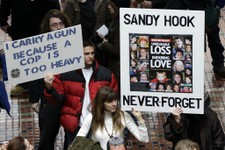 -                Gun rights and gun control advocates demonstrate in the Pennsylvania Capital building Wednesday, Jan. 23, 2013, in Harrisburg, Pa. As a boycott continued to grow over a ban on assault w