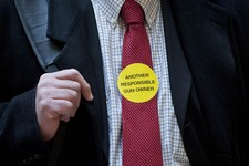 -                Jeff Soracco of Oxford, Conn. wears a sticker identifying him as a responsible gun owner as he waits to sign up to speak at a hearing of a legislative subcommittee reviewing gun laws at