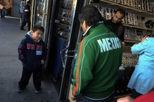 -                Mexican immigrant Roberto Garcia, center, and son Alan, left, look at wrist watches while shopping in Los Angeles, Monday, Jan. 28, 2013. Seeking swift action on immigration, President