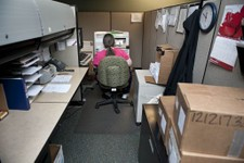 -                This photo taken Jan. 23, 2013 shows tracer Wendy Myer working to trace the ownership of a firearm used in a crime in a cubicle crowded with boxes of firearms transactions from dealers