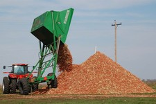 -                FILE - In this Oct. 30, 2007 file photo, a dump wagon adds freshly gathered corn cobs to a pile on a farm near Hurley, S.D. After decades of talk, the ethanol industry is building multi