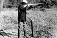 -                FILE - In this Sept. 6, 1928 file photo, U.S. President Calvin Coolidge shoots at clay pigeons at his vacation home on the Brule at Superior, Wis, He scored 29 out of 37. The White Hous