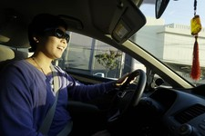 -                In this Jan. 4, 2013 photo, Lyft driver Nancy Tcheou smiles as she drives in San Francisco. Fed up with traditional taxis, city dwellers are tapping their smartphones to hitch rides fro